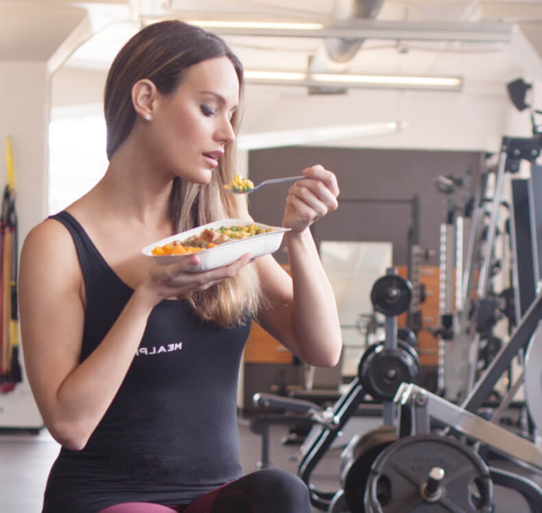 Female Athlete Enjoys the benefits of eating a mealpro meal