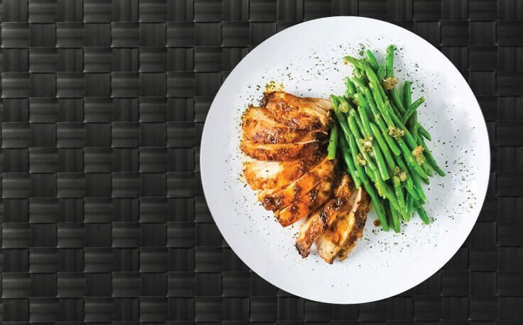 Picture shows lean white protein on a plate with some vegetables as a side
