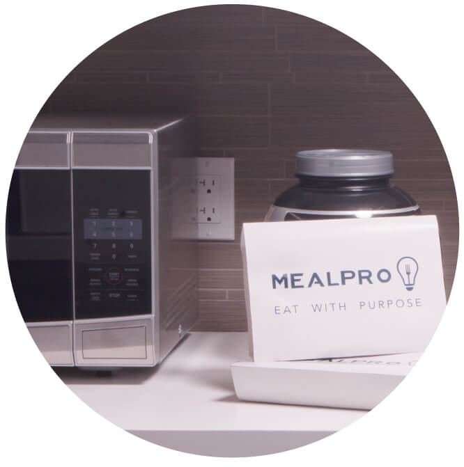 Picture of MealPro meals by a microwave. Your easy  meals are easy and just need to be heated and served. No prep or cleanup required.