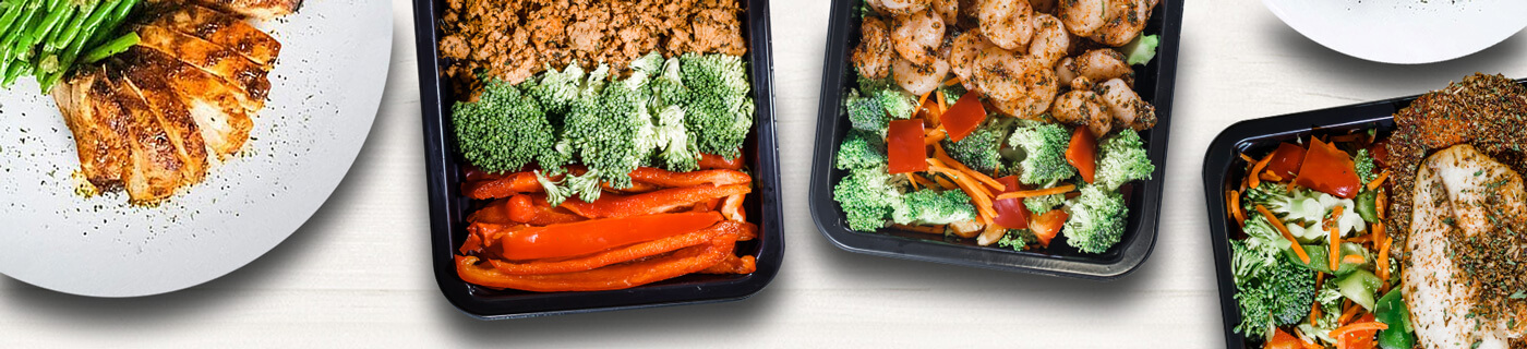 Picture of MealPro's New York atkins diet meal assortment plated in to go containers from a top view