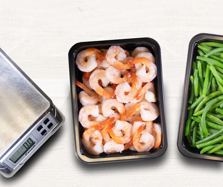 Healthy paleo meals plated in a microwave safe  meal prep containers