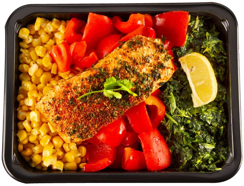 Portioned and cooked  meal plated in a meal prep container. Great for mind and body performance.
